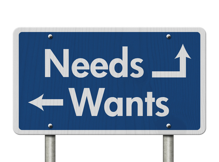 wants: Difference between Needs and Wants, Blue Road Sign with text Needs and Wants isolated over white