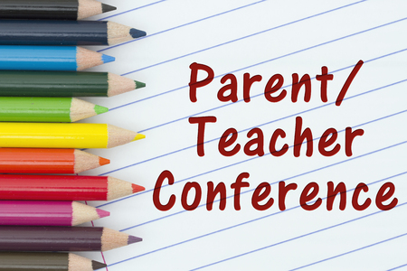 loose leaf: Parent-Teacher Conference, Pencil Crayons with loose leaf paper and text Parent-Teacher Conference Stock Photo