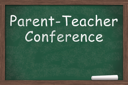 Chalkboard with text of Parent-Teacher Conference with a piece of chalk with copy-space