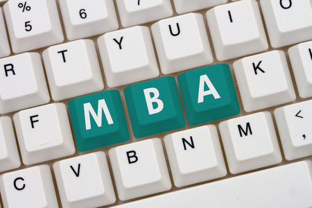 computers online: Getting your MBA online, A close-up of a keyboard with teal highlighted text MBA Stock Photo