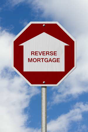 borrowing: Stop Reverse Mortgage Borrowing Road Sign, Red and White Stop Sign with words Reverse Mortgage with sky background