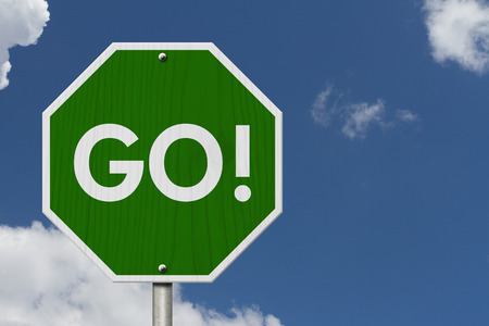 Green Go highway road sign, Green stop highway sign with words Go with sky background