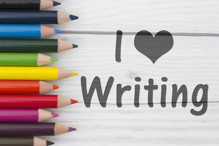 i like my school: Pencil Crayons with text I love Writing with weathered wood background Stock Photo