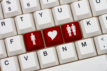 simbolo de la mujer: A close-up of a keyboard with red highlighted symbol of man and two women and heart