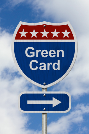 Red, White and Blue American Highway Sign with words Green Card with sky background Stock Photo
