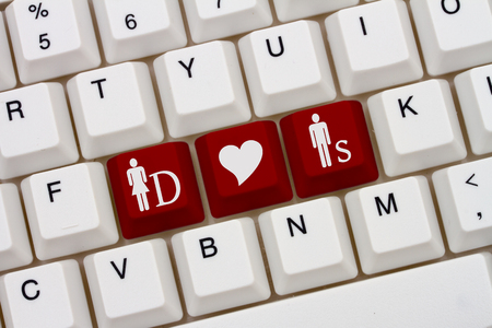 kinky: A close-up of a keyboard with red highlighted symbol of man and two women and heart