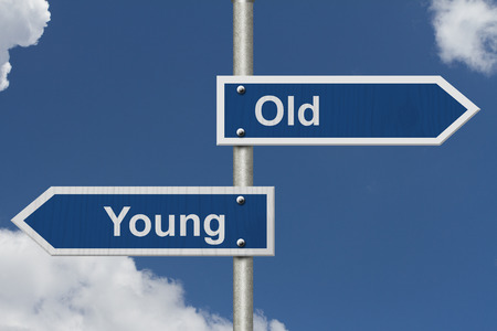 age: Two Blue Road Sign with text Old and Young with sky background Stock Photo