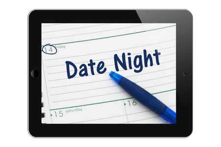 A tablet display with pen and a day planer with text Date Night