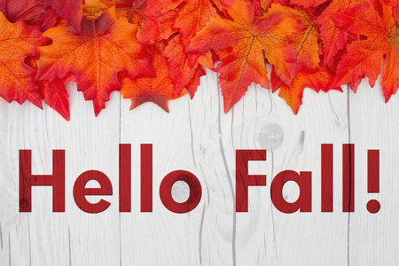 Hello Fall Greeting, Some fall leaves on weathered wood with text Hello Fall