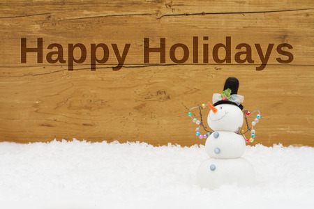 snowman wood: Snowman on snow with weathered wood background with text Happy Holidays