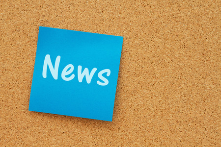 note board: A reminder to get the news message, Bulletin board with a blue sticky note with text News