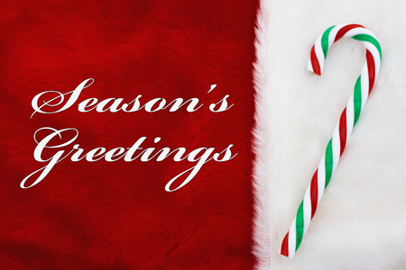 Free Shipping, A plush reSeasons Greetings, A plush red stocking with a candy cane and words Seasons Greetingsd stocking with a candy cane and words Free Shipping Banco de Imagens