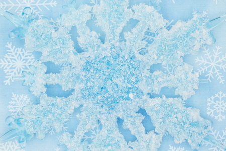 A snowflake with a blue and white snowflakes background