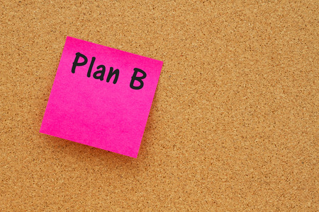 note board: Bulletin board with a pink sticky note with text Plan B