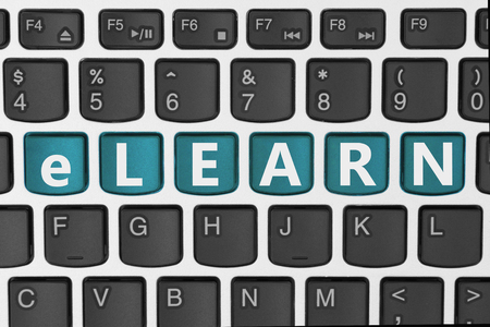 elearn: A close-up of a keyboard with teal highlighted text e-learn