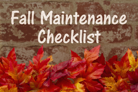 Some fall leaves on weathered bricks with text Fall Maintenance Checklist