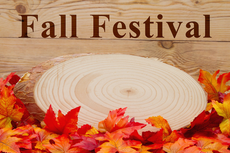 Fall Festival: Some fall leaves and wood plaque on weathered wood with text Fall Festival