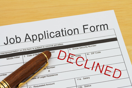 applications: Job application form with a pen on a desk with an declined stamp Stock Photo
