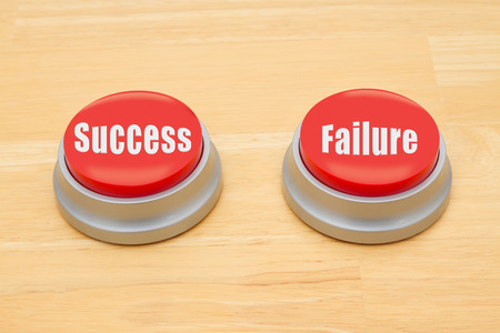 Two red and silver push button on a wooden desk with text Success and Failure Stok Fotoğraf