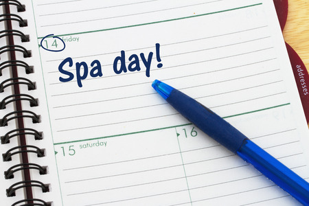 A day planner with blue pen with text Spa Day Stock fotó