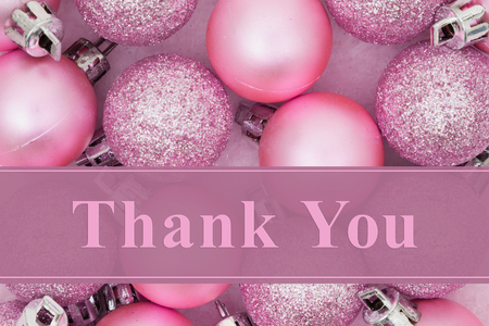 Some pale pink sparkle and matte Christmas ball ornaments with text Thank you