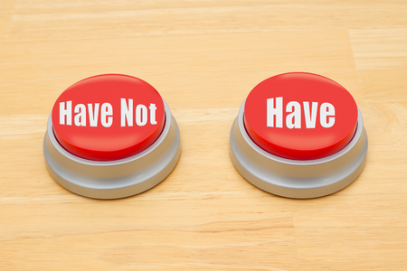 have on: Two red and silver push button on a wooden desk with text Have Not and Have