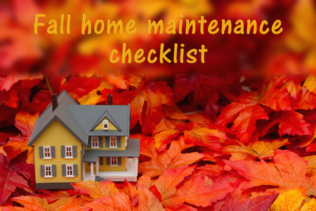 Some fall leaves and yellow and gray house with text fall home maintenance checklist Imagens