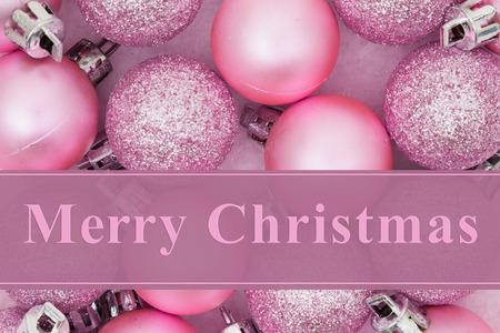 pink christmas: Some pale pink sparkle and matte Christmas ball ornaments with text Merry Christmas Stock Photo