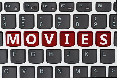 computers online: A close-up of a keyboard with red highlighted text Movies