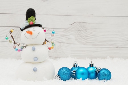 snowman wood: Winter Time Background, Some snow, Christmas ornaments and a snowman on weathered wood with copy space for your message