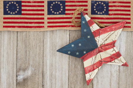 space wood: USA patriotic old flag and star with weathered wood background with copy space for message