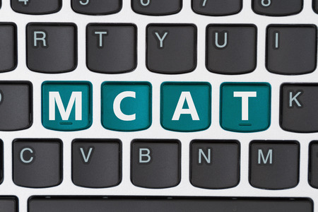 university admission: A close-up of a keyboard with teal highlighted text MCAT Stock Photo