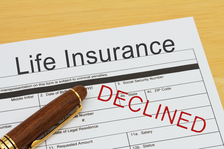 Applying for a Life Insurance Declined, Life Insurance application form with a pen on a desk with an declined stamp Stockfoto