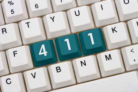 computers online: A close-up of a keyboard with teal highlighted text 411