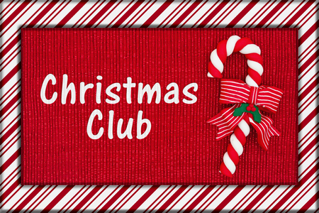 christmas savings: Christmas savings club message, Red shiny fabric with a candy cane and candy cane border with text Christmas Club