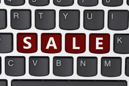 computers online: A close-up of a keyboard with red highlighted text Sale Stock Photo