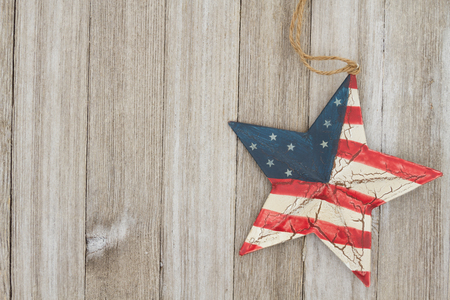 USA patriotic old flag on a star with weathered wood background with copy space for message