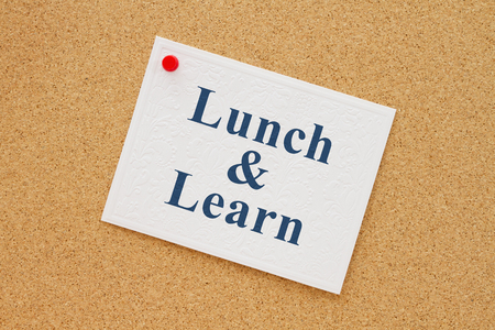 note board: Bulletin board with a white note with text Lunch & Learn