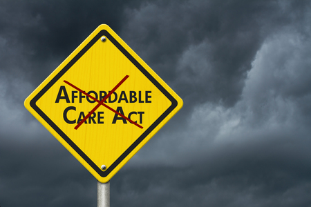 affordable: Yellow warning highway road sign with words Affordable Care Act crossed out with stormy sky background