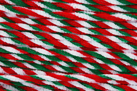 Red, white and green candy cane pipes Christmas background