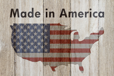 USA patriotic old flag on a map and weathered wood background with text Made in America