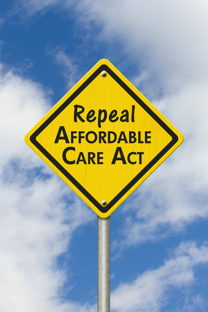 Yellow warning highway road sign with words repeal Affordable Care Act with sky background