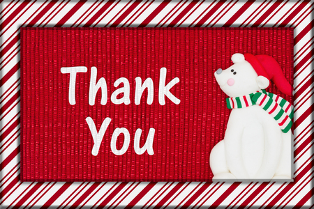 Red shiny fabric with a candy cane border and a Santa polar bear with text Thank You