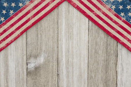 USA patriotic old flag on a weathered wood background with copy space for your message 写真素材
