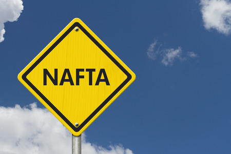 nafta: Yellow caution sign with words NAFTA with sky background