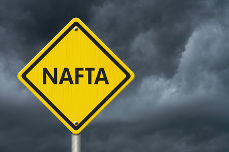 nafta: Yellow caution sign with words NAFTA with stormy sky background