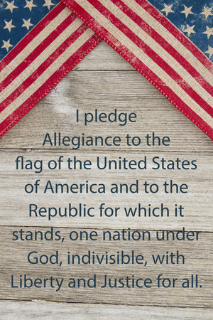 pledge: USA patriotic old flag and weathered wood background with text of the Pledge of Allegiance Stock Photo