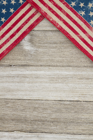 USA patriotic old flag on a weathered wood background with copy space for message