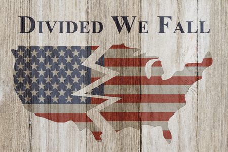 divided: USA patriotic old flag on a map and weathered wood background with text Divided We Fall