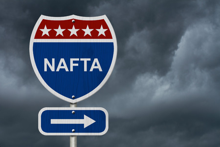 nafta: Red, white and blue interstate highway road sign with words NAFTA with sky background
